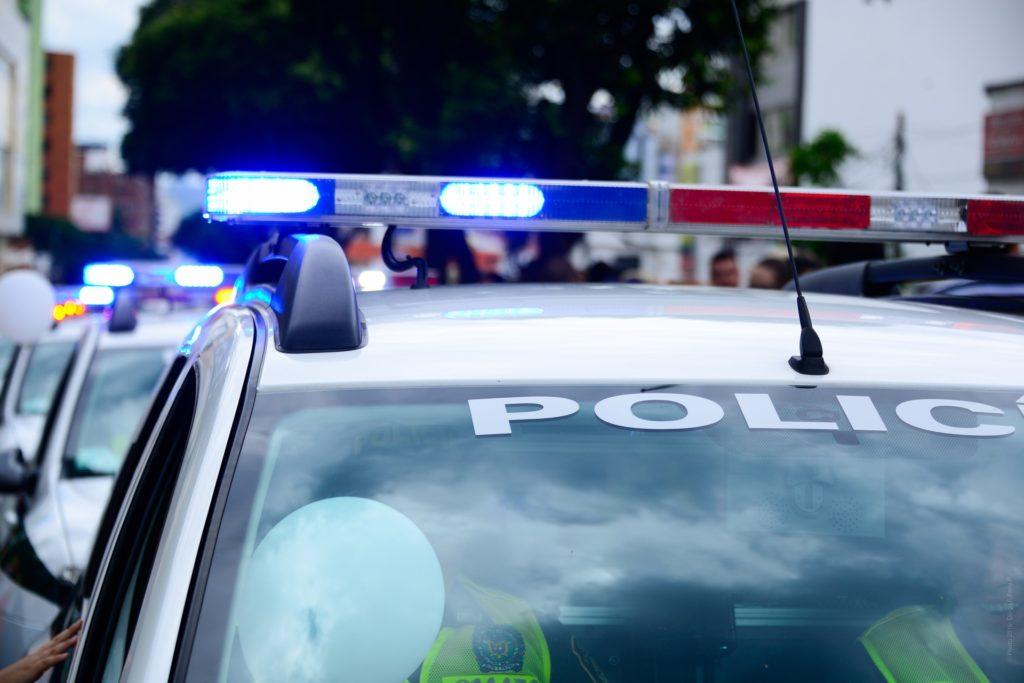 postępowanie Policji po wypadku, auto Policji w trakcie czynności